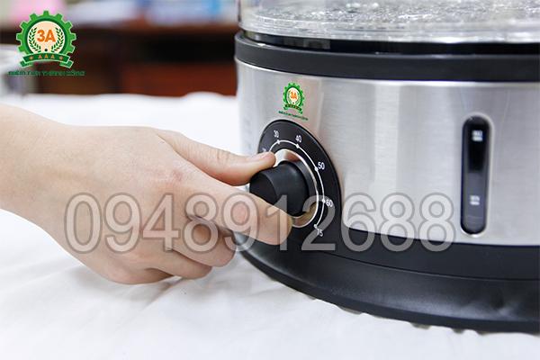 Vặn nút điều chỉnh thời gian làm chín nguyên liệu của nồi hấp mini 3A
